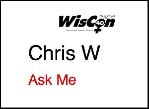 A WisCon 40 member badge with 'Ask Me' printed in red