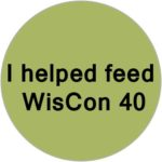 "A green circle, overlaid with black text reading ""I helped feed WisCon 40"""